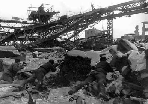 Georgi Zelma Stalingrad, c. 1942 [Soldiers taking cover in the ruins near a Factory